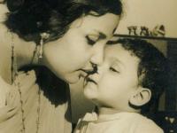 With elder son, sharing a secret.
