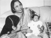 With First Grandchild Riyasha-In 2003.